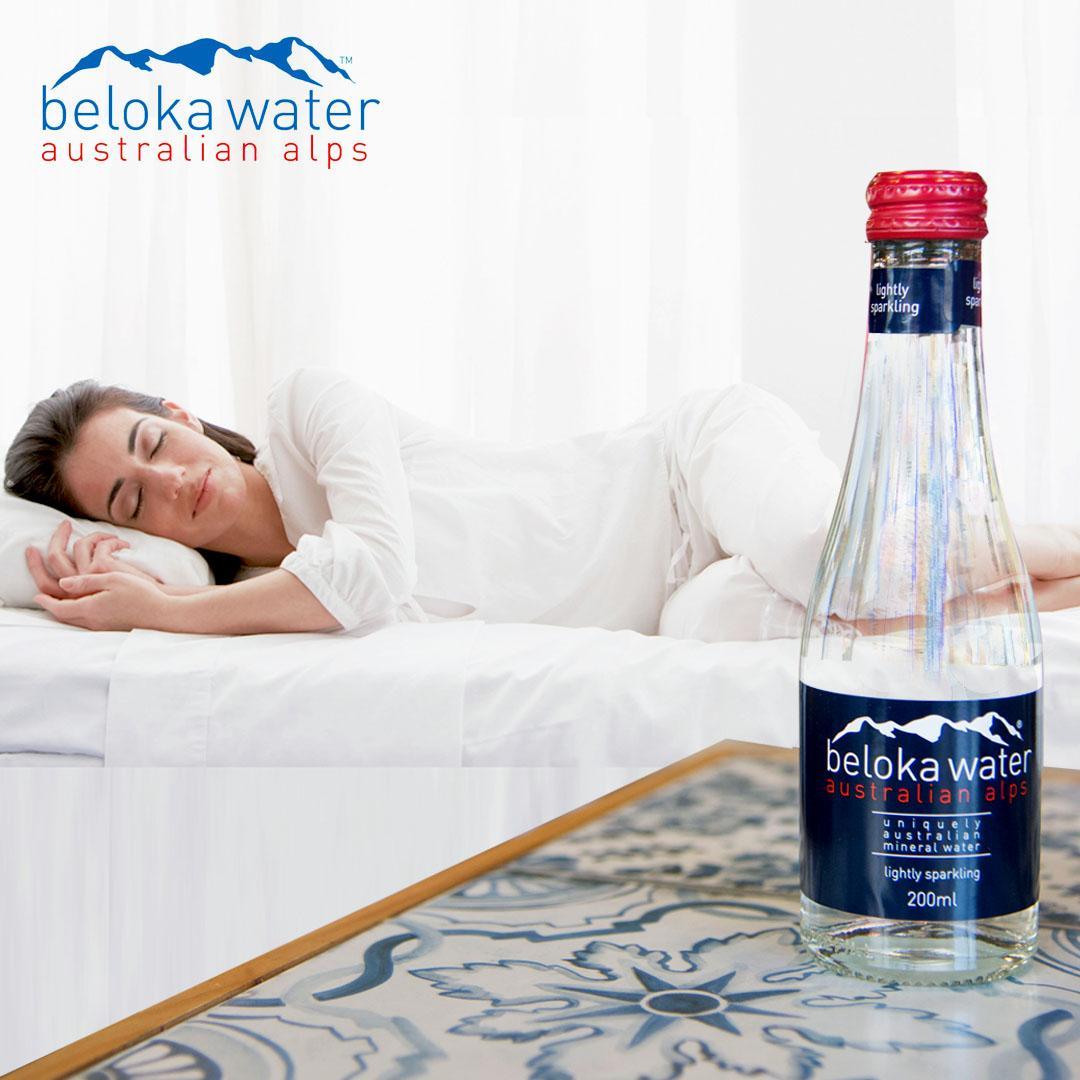 woman sleeping bottle water